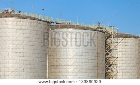 Cargo transport commerce concept. Silo in morning harbour. Storage building in port.