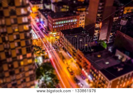 Aerial View Of Manhattan At Night. Tilt-shift Effect Applied