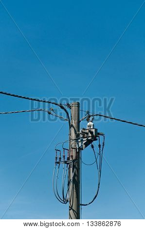 old light pole with wires and boxes of light electricity