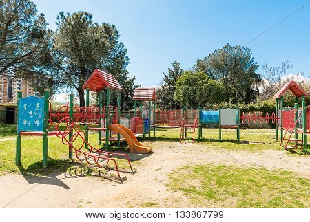 Colorful Playground For Kids Inside A Urban Public Park, Italy