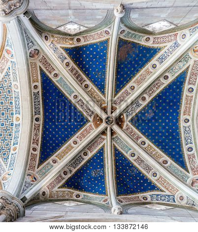 Ceiling of the Certosa di Pavia. The monastery is typical of the Lombard architecture and combines Gothic and Renaissance styles. It was built by Carthusians in 1396-1495.