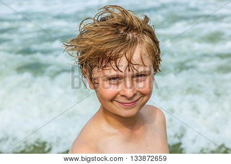 Boy Enjoys The Beautiful Beach