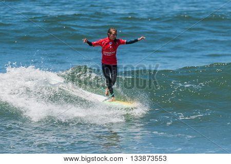 GAIA PORTUGAL - JUNE 11, 2016: Carole Lormant (FRA) at LQS Longboard Pro Gaia Women's Longboard Tour #3.