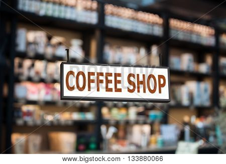 Coffee shop signboard with cafe blurred background, stock photo