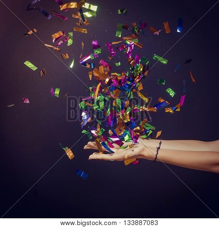 Party time - hands full of confetti