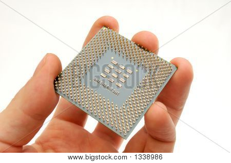 Hand Holding A Microprocessor
