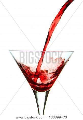 Pouring vermouth in a glass with splash