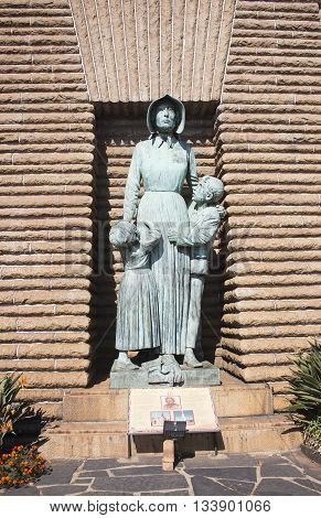 South Africa Pretoria - 28 June 2016: Anton van Wouw's bronze sculpture of a Voortrekker woman and her two children paying homage to the strength and courage of the Voortrekker women.