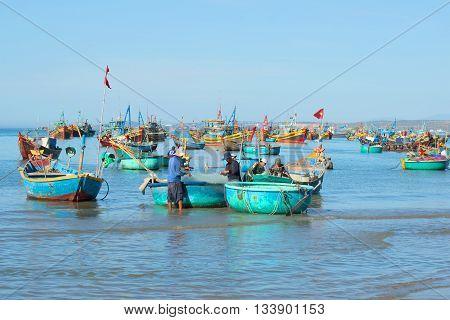 MUI NE, VIETNAM - DECEMBER 25, 2015: Fishermen are preparing to go to sea to fish in the Fishing harbour of Mui Ne