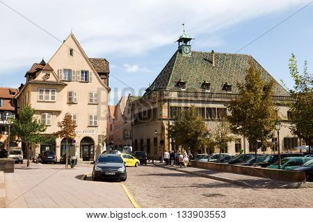 COLMAR FRANCE - SEPTEMBER 10 2010: Colmar cityscape in Alsace France. The Fruit Market square in the old town of Colmar.