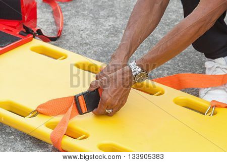 physician yellow stretcher readiness medical equipment. assist patient in emergency rescue situations.(select focus front hand physician and soft-focus background)