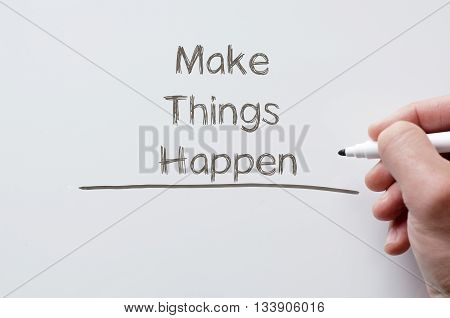 Human hand writing make things happen on whiteboard