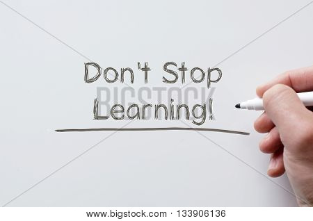 Human hand writing don't stop learning on whiteboard