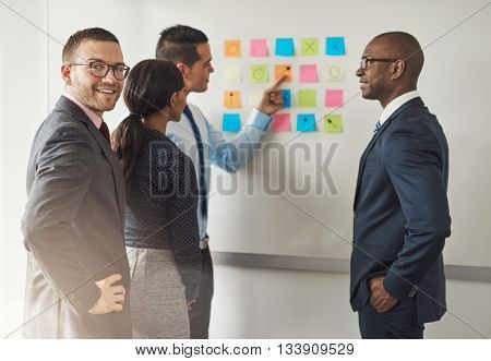 Group Of Businesspeople Solving A Puzzle