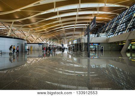 SHANGHAI, CHINA - MAY 27: Pudong Airport interior on June 7, 2016 in Shanghai, China. Pudong airport is the busiest international hub of mainland China, third busiest by cargo traffic in the world.