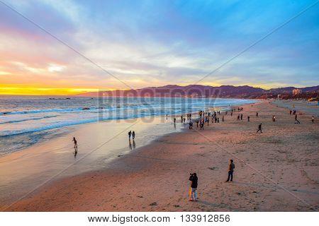 Los Angeles, CA, USA - January 11, 2016: Beach Santa Monica pier at sunset, Los Angeles