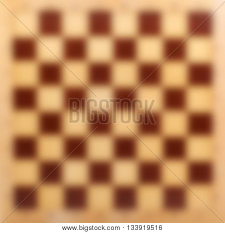 Abstract blur wooden chessboard backdrop, bokeh background