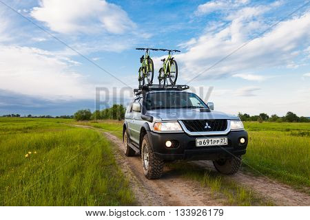 PRIAMURSKY RUSSIA - JUNE 10 2016: Mitsubishi Pajero Sport with two bicycles on roof rack