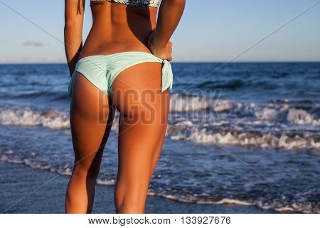 woman back and ass with bikini in seashore
