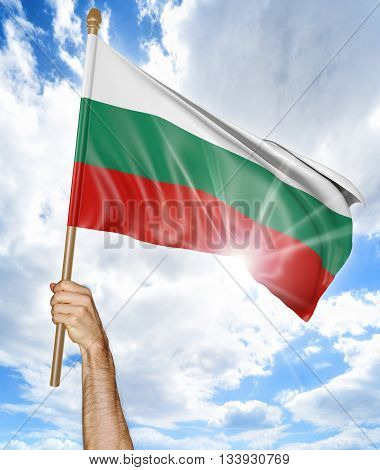 Person's hand holding the Bulgarian national flag and waving it in the sky, part 3D rendering
