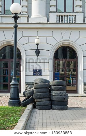 Dnepropetrovsk Ukraine - October 05 2015: Car tires in front of the main entrance in the Dnipropetrovsk regional administration in protest