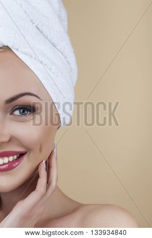 Analysing flawless beauty. Beautiful woman caressing her perfect skin isolated on brown background in studio