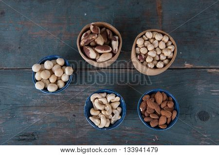Various nuts on old wooden vintage table