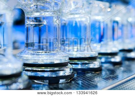 Abstract Background With Blue Glass Tubes.