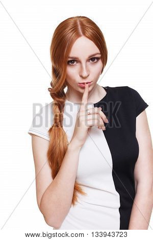 Keeping secret. Young beautiful woman with finger on lips, hush sign. Adultery, cheating, sexual secret concept. Redhead girl with forefinger on lips isolated at white