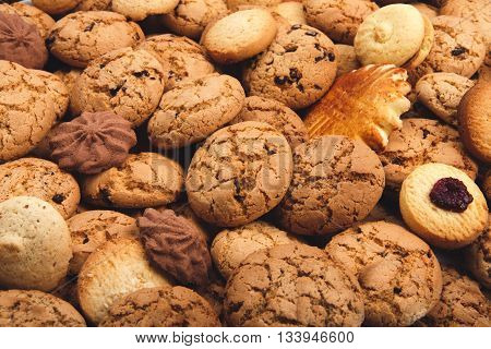 Cookies background. Sweet chocolate chips biscuits, shortbread and cookies with jam texture background. Oatmeal, chocolated drops and other sweets. Dessert, sweets for tea. Fattening sweets concept