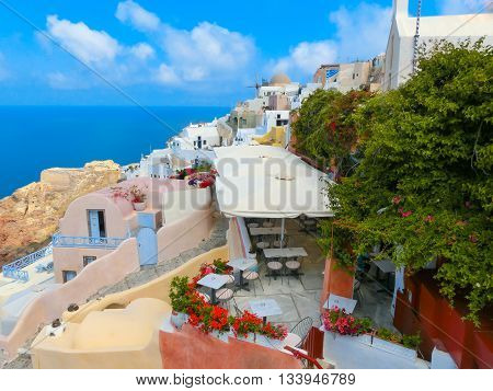 Oia, Greece - June 10, 2015: Santorini - The restaurant geared to romantic diner in Oia and the sea in the background. Beautiful terrace with sea view on Santorini island, Oia, Greece.