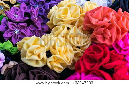 Flowers made from multi-coloured fabric. Do a hairgrip