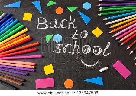Back to school background with colorful felt tip pens pencils title