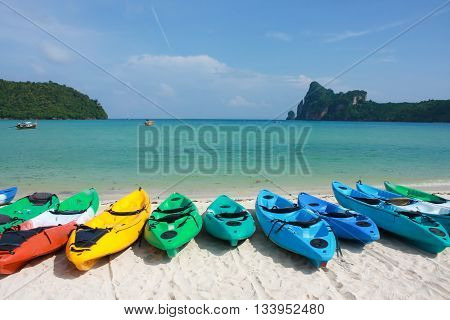 kayak on white sand beach with clear blue sky and sea background at Pi Pi islands Thailand
