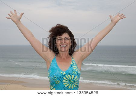 Happiness bliss freedom concept. Woman happy smiling joyful with arms up