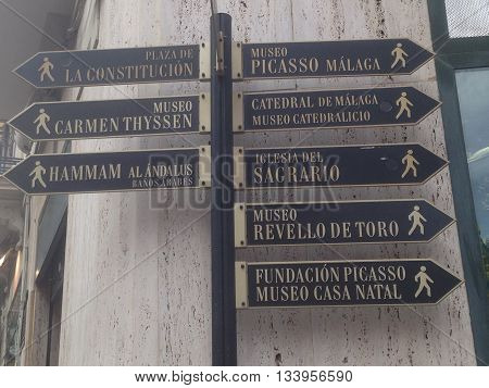 Turistic sign in Malaga in the costa del sol (Spain) A turistic sign in Malaga, with the directions of carmen thyssen museum or picasso museum