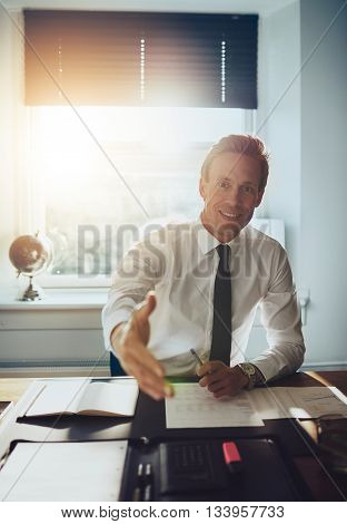 Business Man Holding Out Hand To Close Deal