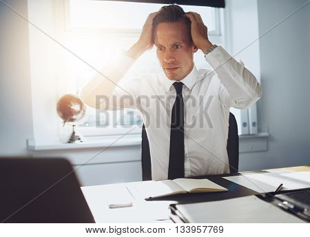 Frustrated Business Man Looking At Laptop