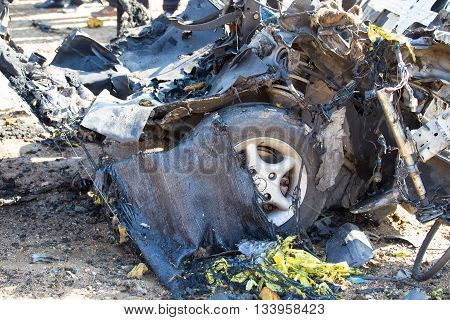 car wrecked from car bomb in crime scene