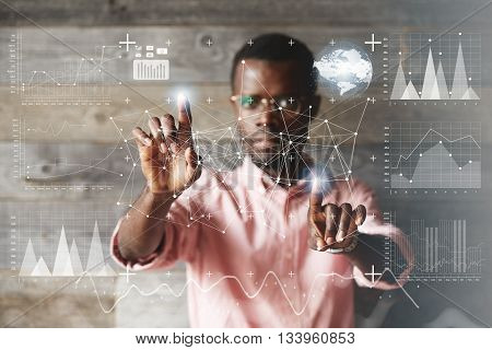 Double Exposure. Black Young Businessman Wearing Glasses And Casual Shirt, Touching Futuristic Scree
