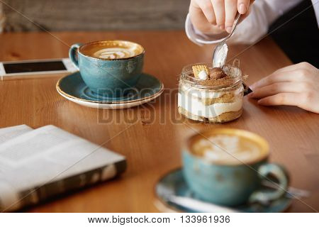 Close Up Shot Of Woman's Hands Eating Sweet Dessert With A Spoon. Young Female Office Worker Having