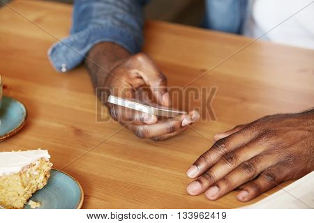 Film Effect. Close Up Shot Of African Man's Hands Holding Mobile Phone While Using Wireless High-spe