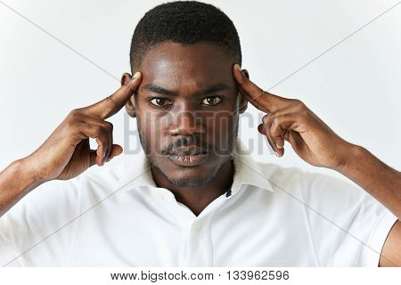 Black Man In White Polo Shirt Having Bad Headache. Young African American Male Thinking Over Or Tryi