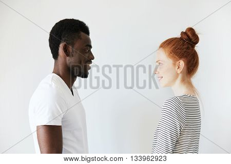 Sideways Portrait Of A Happy Couple Staring At Each Other In White Morning Room. Afro Amercian Man I