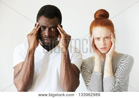 Interracial Relationships Concept. Black Man In White Polo Shirt And His Caucasian Redhead Wife, Hav