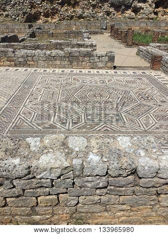 Roman mosaic and columns in Conimbriga, Portugal