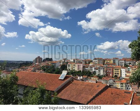Clouds over shingled rooftops in Coimbra, Portugal