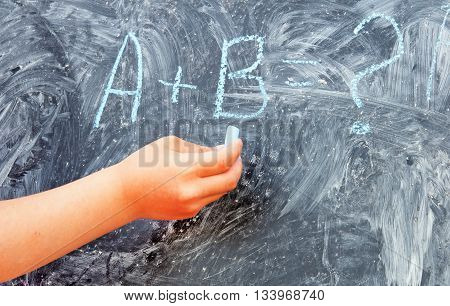 a + b = written on the chalkboard