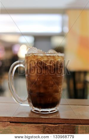 Glass of cola on a table in a restaurant, Soda beverage for quenching thirst.