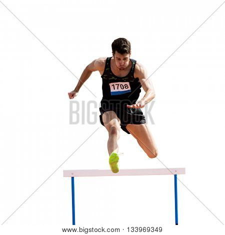 Sportsman practicing hurdles in a white background